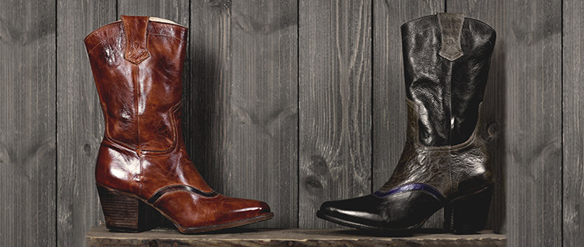 2 western boots facing each other, a cognac leather Basanti and a Black with purple details Basanti
