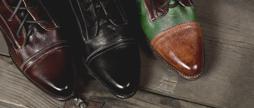 Top view of 3 cap toe Baisley vegetable tanned boots in teak, black and green and tan multi colors
